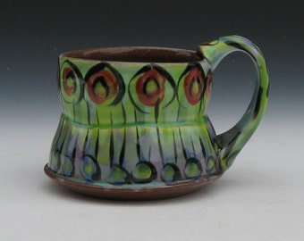mug with stripes and circles lime green with purple black stripes red black circles