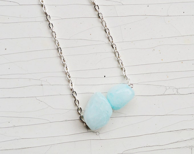 Pastel blue necklace.