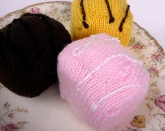 three hand knitted Fondant Fancy buns