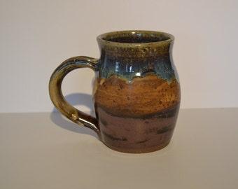 Large stoneware coffee or tea mugs.