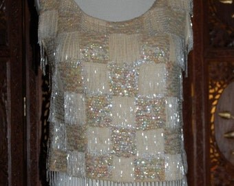 ON SALE Vintage 1950s cream lambswool shell with opalescent long beads and  sequins