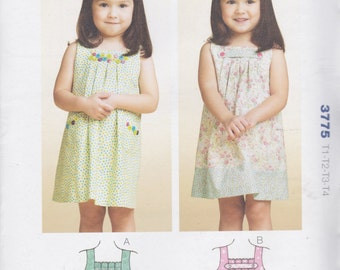 Kwik Sew Pattern 3775 Sweet Pullover Sleeveless Dresses with Box Pleated Front Neckline, Back Button Closing Toddler's Sizes T1 - T4