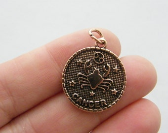 2 Cancer pendants antique copper tone