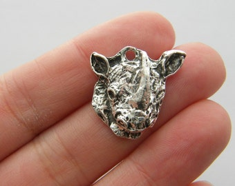 4 Rhino charms antique silver tone A457