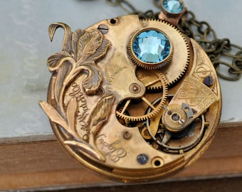 steampunk necklace LOVE TAKES TIME antique year 1900s Elgin brass vintage pocket watch with iris flower and aqua blue Swarovski rhinestone