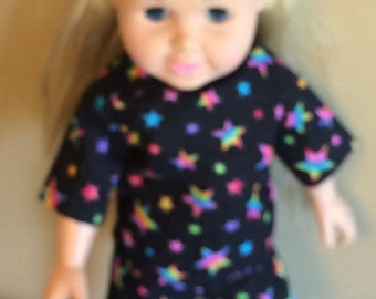 A RAINBOW of Stars on a Black Background. TUNIC Top with Three Quarters Sleeve and Stand-up Collar, Elastic Waist SHORTS w/Rose on Headband.