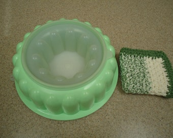 Vintage Tupperware Jello Ring Mold with a Hand - Crocheted Washcloth