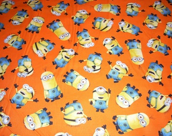 """Minions on orange - 1 in a Minion - by Quilting Treasures - Character Fabric - cotton fabric  -  44"""" wide - sold by the yard"""