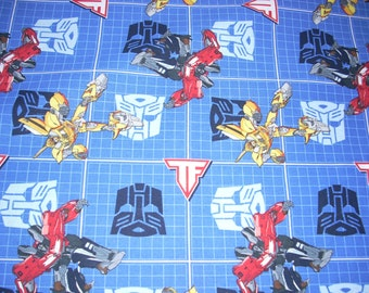 """Transformers on blue - cotton fabric  - 44"""" wide - sold by the yard"""