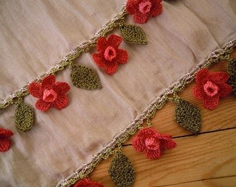 beige cottpn scarf with salmon pink flowers