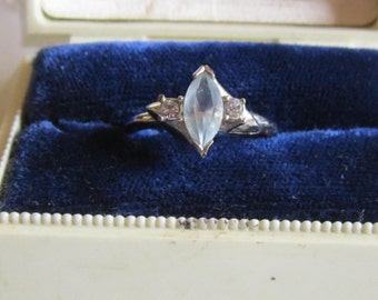Vintage Avon Silver Tone Ring with Pale Blue Rhinestone and Small Clear Rhinestones