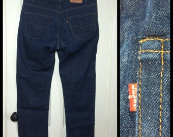 Vintage Levi's 505 jeans, labeled 42X30, measured 42x31 Straight Leg Blue Jeans 1980's made in USA 42 inch Waist black stitch #1249