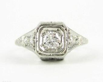 Platinum Filigree Diamond Engagement Ring, Old European Cut Diamond in Floral Style Setting. Circa 1920s, 0.37 ctw.