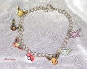 Custom made Pokemon Eevee Evolution Eeveelution Charm Bracelet - by Torres Designs - Collectible Gift - Ready To Ship