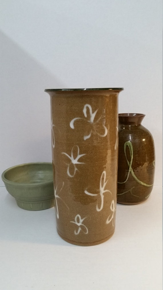 Art Pottery Vase. Artist made Glazed tan pottery with white flowers. Wheel Thrown. Speckled clay