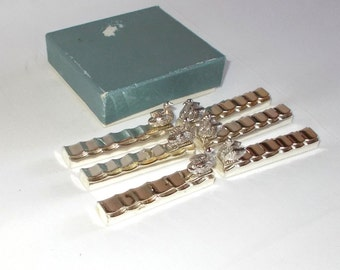 REDUCED  -  6 dainty vintage Knife rests in original box. Swan/duck on rippling water.  (3641)