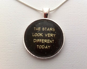 "Tribute to David Bowie: ""the stars look very different today"" Space oddity lyrics under a glass dome- 25mm (1in)"