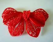 Vintage Lacy Red Celluloid Bow Pin