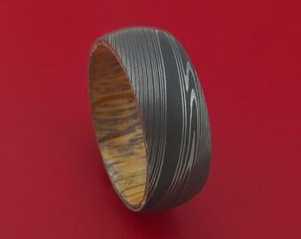 Damascus Steel Ring with Whiskey Barrel Interior Wood Sleeve Custom Made