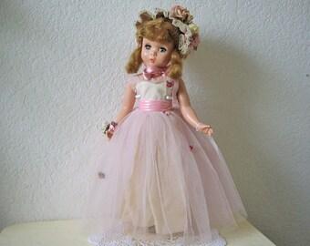 "Madame Alexander ""Rosamund Bridesmaid"" Doll, in original outfit, 1950s Hard plastic."