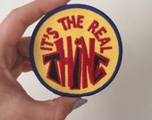 "Vintage ""its the real thing"" iron on patch"