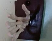 spooky skeleton hand Ukulele wall hanger, right facing.