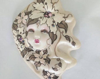 Adagio Lacy lady handpainted in whites and light pinks and beige colors.