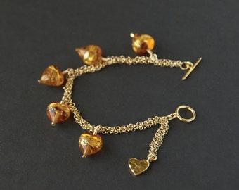 Murano glass gold hearts chain bracelet. Venetian glass heart bracelet. Murano glass jewellery. Love heart beaded gold chain bracelet.