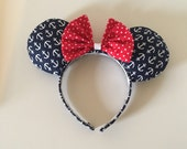 Ahoy matey!  Navy and white anchor ears with a red and white polka dot bow