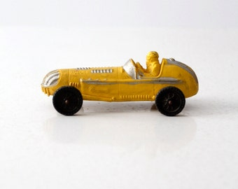 vintage Auburn toy car, Indy style race car, yellow rubber car
