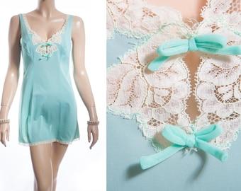 Pretty 'Charnos' sheer silky soft aquamarine nylon and delicate cream lace and bow trim detail 1960's vintage mini slip petticoat - 3472