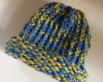 Knitted newborn baby hat. Blue and green. New baby gift