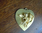 Vintage gold tone raised Cupid on a Heart Charm