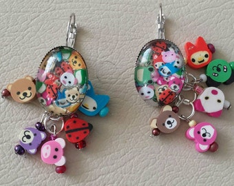 Sale was 17 now 15uk Silvertone Oval Cabochon Cute Cartoon Animal earrings with Animal dangles.