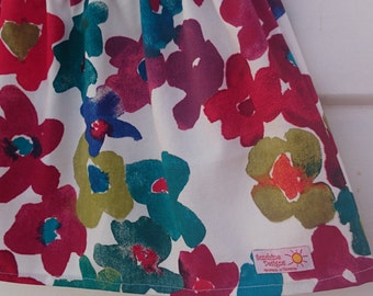Girls skirt. Heavy weight cotton with floral pattern. Sizes 1-8 Years. Matching hairties.