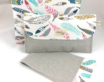 Diaper clutch nappy bag wallet with travel change mat and wet bag set. Feathers on natural linen. Best baby shower gift