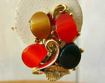 vintage 50s lucuite thermoset earrings clip on gold tone multi color orange green tan