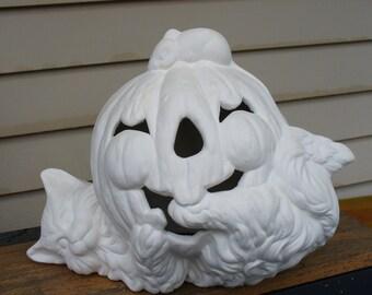 Ceramic Bisque Cat under a Pumpkin