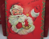 1940's-50's embossed colorful unused christmas card santa claus holding a candle holder with red candle