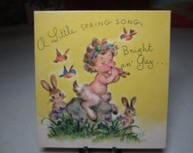 1940's-50's Rust Craft artist signed Marjorie Cooper easter greeting card shows mythological pan playing flute on rock bunnies and birds