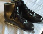 Vintage boys black ice skates, holiday time