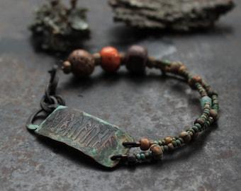 Good luck runic bracelet, rustic amulet bracelet, pagan rune bracelet, etched charm bracelet, earthy two-strand bracelet, norse jewelry