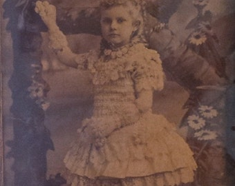 Antique wood picture frame with photo of girl with beautiful lace dress and gloves. Unique picture.