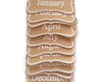Kraft Die-Cut Months of The Year in White by Maya Road - 24 Pieces
