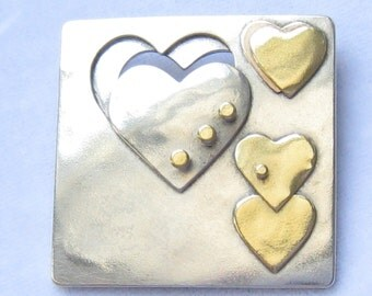 "SALE Modernist Hearts Brooch in Silver, Brass, with Part of 1 Copper Heart Visible.  Done in 4 Layers.  Square: 1.5"" x 1.5""."