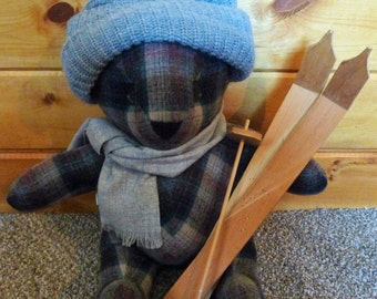 plaid bear  with wooden skis