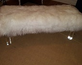Mongolian Lamb bench with wood legs.