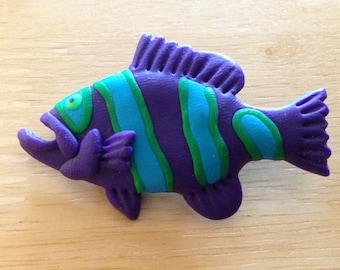 Purple fish pin.