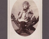 Cabinet Card of a Child Clutching a Teddy Bear