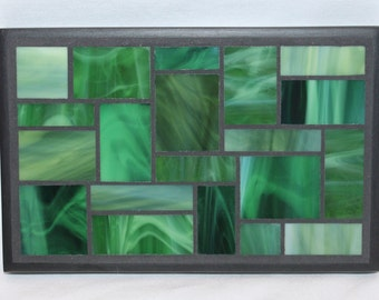 Green glass mosaic trivet with black wood trim